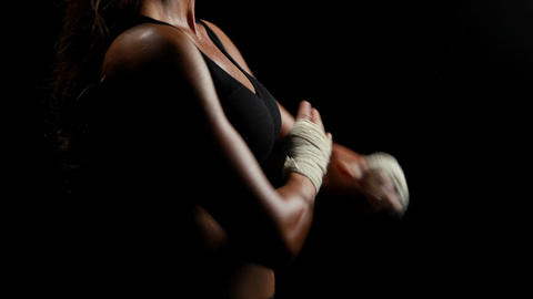 Muscular woman wearing bandage and folding arms Footage