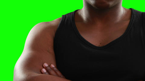 Muscular man with arms crossed looking at camera Footage