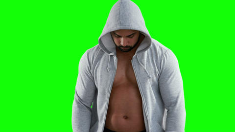 Muscular man wearing grey hood Footage