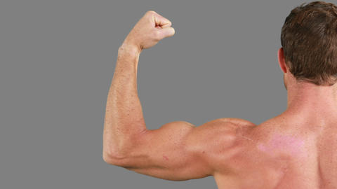 Muscular man flexing his muscles Footage