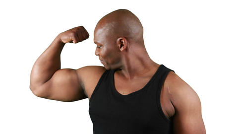 Smiling muscular man with meat flexing muscles Footage