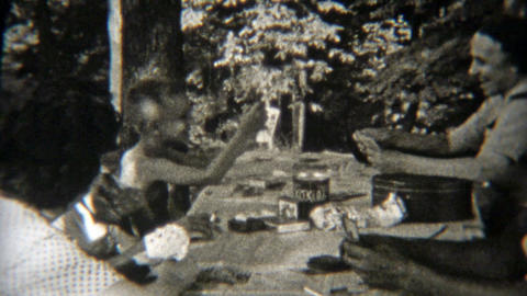 1949: Family playing poker outdoors while camping Footage