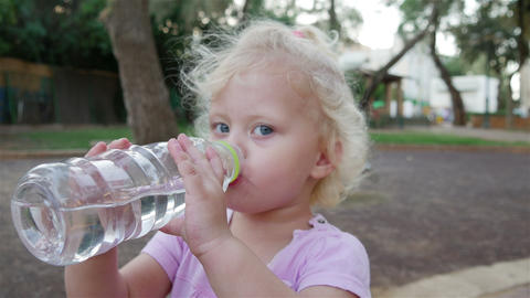 Little Girl Drinks Water From A Bottle Footage