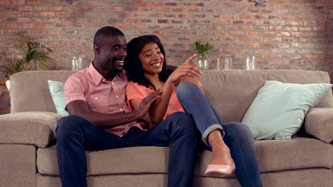 Happy couple sitting on the couch Footage