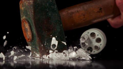 Hammer smashing a light bulb Footage