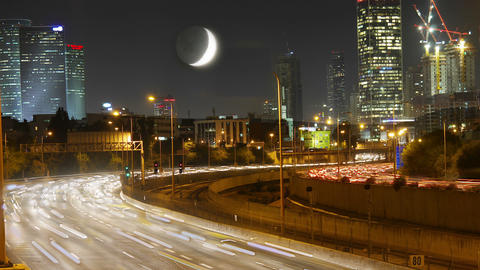 Traffic. Moon over the city. Time lapse Footage