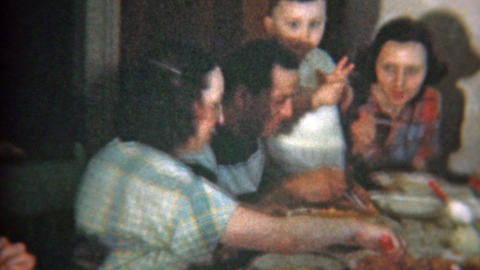1951: Big family at crowded dinner table eat Italian food Footage