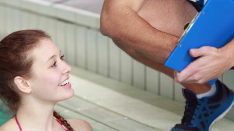 Woman doing aqua aerobics with trainer Footage