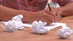 Casual businessman writing notes on paper Footage