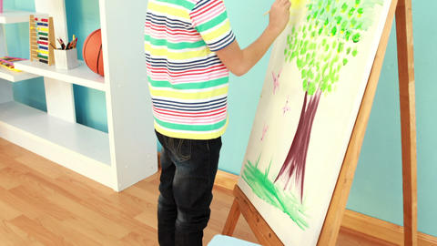 Little boy painting a picture Footage