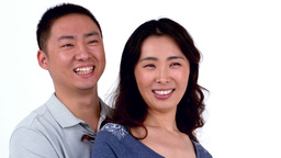 Portrait of Asian smiling couple hugging Footage