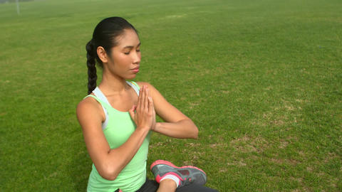 Peaceful sporty woman doing the lotus pose Live Action