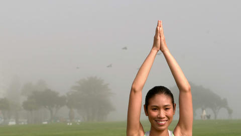 Smiling sporty woman doing yoga Footage