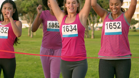 Cheering women winning breast cancer marathon Footage
