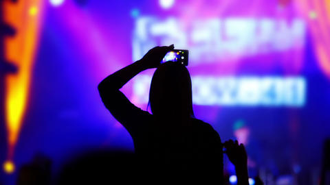 Girl Records Video of a Rock Concert to her iPhone Footage