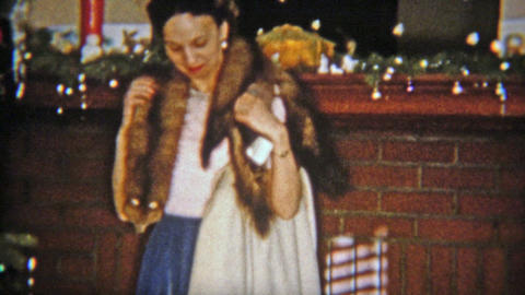 1954: Women gets mink fur stole for Christmas gift Footage