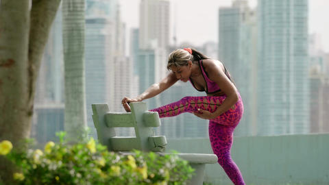 11 Woman Doing Stretching Before Sports Training At Morning GIF