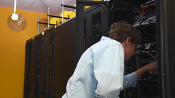 Datacenter Administrator Checking Servers stock footage