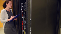 Female IT Administrator With Male Technician In Server Room stock footage