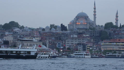 Tourist ships in the passage the Gold Horn against the mosque Suleymaniye Footage