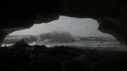 Heavy waves rolling into a cave and hit camera Footage