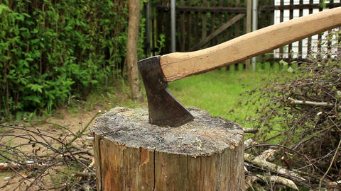 Axe Stuck In Stump And Firewood stock footage