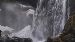 Storm blowing over Icelandic waterfall Footage