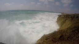 Waves splashing over the cliffs, real time in 2.7K Footage