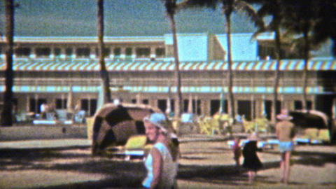 1962: Classic beach hotel with vintage sunning cabana on the sand Footage