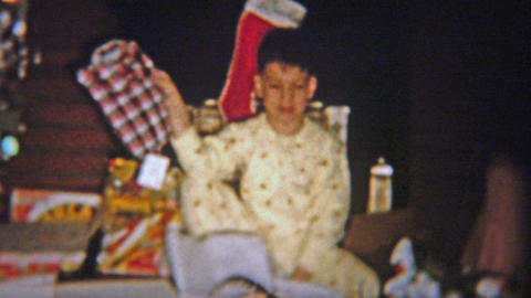 1954: Boy gets boring flannel shirt for Christmas gift Footage