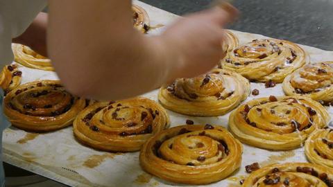 german bakery spread liquid sugar on a pastery roll 4k 11714 Footage