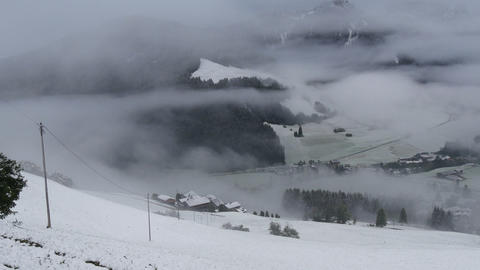 pan over foggy and snowy dolomites prags valley 11715 Footage