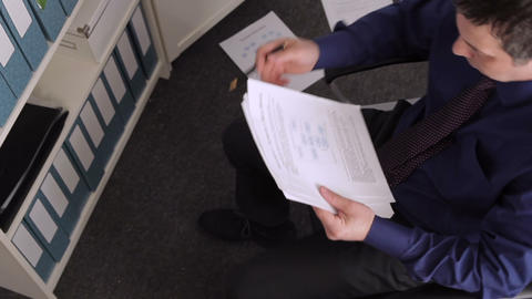 Businessman Working with the Documents and Crumpling Paper Live Action