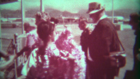 1966: Hawaiian flower leid greeting as you get off the airplane flight Footage