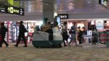 Singapore Changi Airport 11 passengers and airport staff 60fps native slowmotion Footage