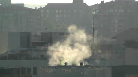 Steam over Rooftops 02 dawn Stock Video Footage
