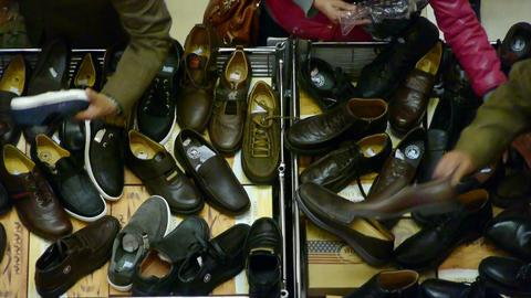 People choose shoes at stall,Various varieties of styles Stock Video Footage