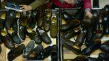 People choose shoes at stall,Various varieties of styles Footage