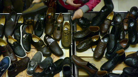 People choose shoes at stall,Various varieties of styles Stock Video Footage