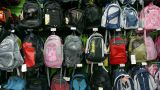 Many backpack on the counter at mall Stock Video Footage