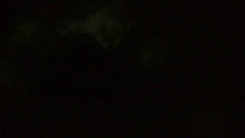 move full moon through cloudy,night flight over clouds... Stock Video Footage