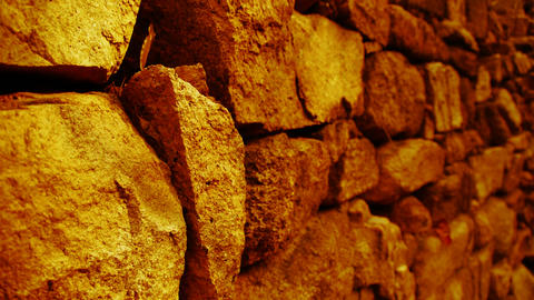 shine golden sunlight on stone wall,travelers back and... Stock Video Footage