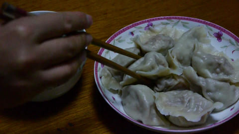 use chopsticks eating dumplings,tradition chinese new... Stock Video Footage