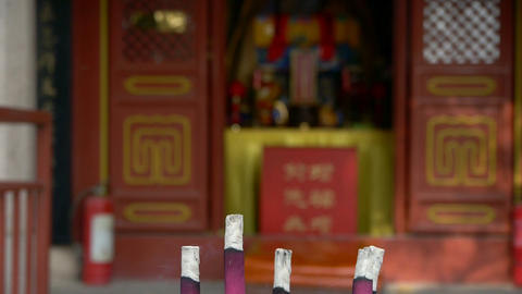 Taoist statues Buddha in door,Burning incense in Incense... Stock Video Footage