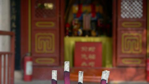 Taoist statues Buddha in door,Burning incense in Incense burner,Wind of smoke Footage