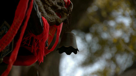 Dragon and metal bell on censer,Red ribbon blowing in... Stock Video Footage