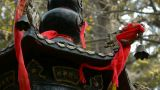 Dragon and metal bell on censer tower,Red ribbon blowing in wind,Trees,shade Footage