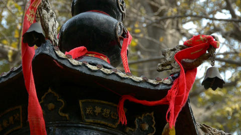 Dragon and metal bell on censer tower,Red ribbon blowing... Stock Video Footage