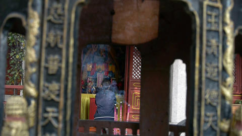 A woman burning incense,bowed,devout worship,Wind of smoke Footage