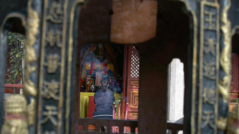 A woman burning incense,bowed,devout worship,Wind of smoke Stock Video Footage